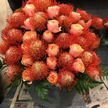 Exotic bouquet of protea and Vuvuzela roses