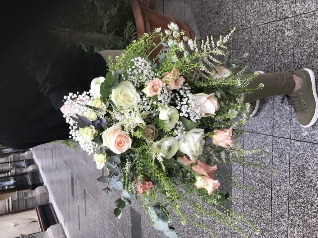 Wild bridal bouquet in peach and white for April wedding