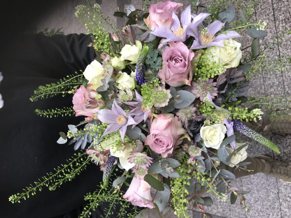 A bridal bouquet in vintage shades of pink, mauve and soft greens